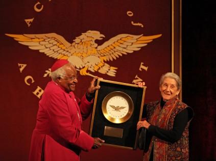 Nadine Gordimer receiving the Academy of Achievement Golden Plate award from fellow Nobel Prize laureate Archbishop Desmond Tutu in 2009. Gordimer won the Nobel prize for literature; Tutu won the prize for peace. (Image: Academy of Achievement)
