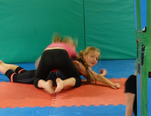 Shannon Morison (left) and Abigail Hart van Deventer practise their grappling.