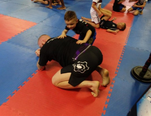 Emmett van der Sandt wrestles with JP Kruger.