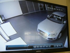 The thief drives the Audi Q5 out of the dealership's premises.