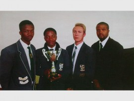 Veritas College's rugby team players, Dikgosi Maseko (left), Alrin Mothibe, Luke Stander and coach Justin Brink.