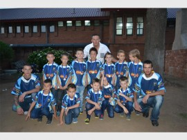 The players from the U/7 team proudly pose alongside their coaches with their medals, at the annual Springs Youth Rugby Club's prize giving on Saturday night.