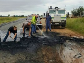 Julie Grose (left), Gary Wiblin and Dennis Grose from the Endicott/Vischkuil CPF and Rural Safety clean the road at KwaZenzele Informal Settlement.