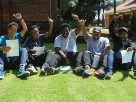 Springs Boys' High School learners Lesedi Moagi (left), Zipho Gumede, Karabo Mokgawaisana, Innocent Ngwenya and Monwabisi Nzutha celebrate their matric results.