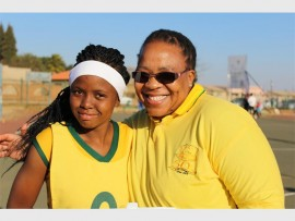 Captain of Phahama Secondary School netball team, Michelle Letsholo with Ntombi Menzi, coach of the team after their last win for the day.
