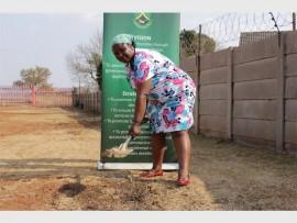 Westonaria Executive Mayor, Nonkoliso Tunzi turning the soil where the rehab care centre will be built.