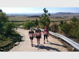 Runners from the club walking up a steep hill during the race. Photo submitted.