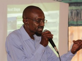 Malik Mosesanyane explains to patients' families what the next steps are after the closure of Life Esimeni Care Centre.