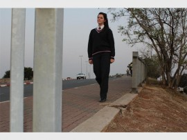 Ilonka Henning, a pupil of Hoërskool Riebeeckrand walking on the 6th Street Bridge. Police warn pedestrians when using this crossing. Photo: Roxy de Villiers.