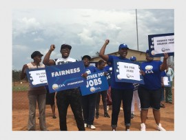 The DA Westonaria caucus in Simunye holding up picket signs in protest of what they call unfair job recruitment processes in the Westonaria Local Municipality. Photo: Submitted. WEB ONLY.
