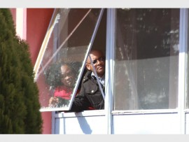 Municipal officials looking out of the window to see what the commotion was about.
