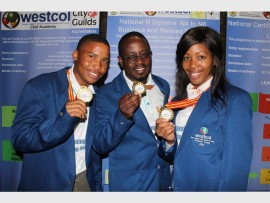 Oratile Manyedi, coach John Magocha and Brenda Nkanbimde with their medals won at the Technical Vocational Education and Training (TVET) Students' National Debate.