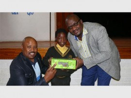 Shani Sihlangu, Helen Mmusi and Mzi Khumalo. Helen is excited about her new shoes.