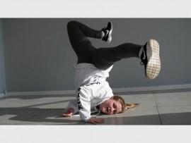 Caitlin Fitzpatrick, dancer and dance teacher at Snap Back Studios striking a pose.