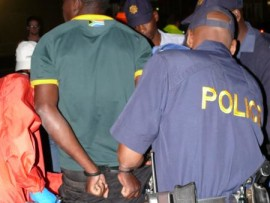 Suspect being arrested at the Greenhills Circle.