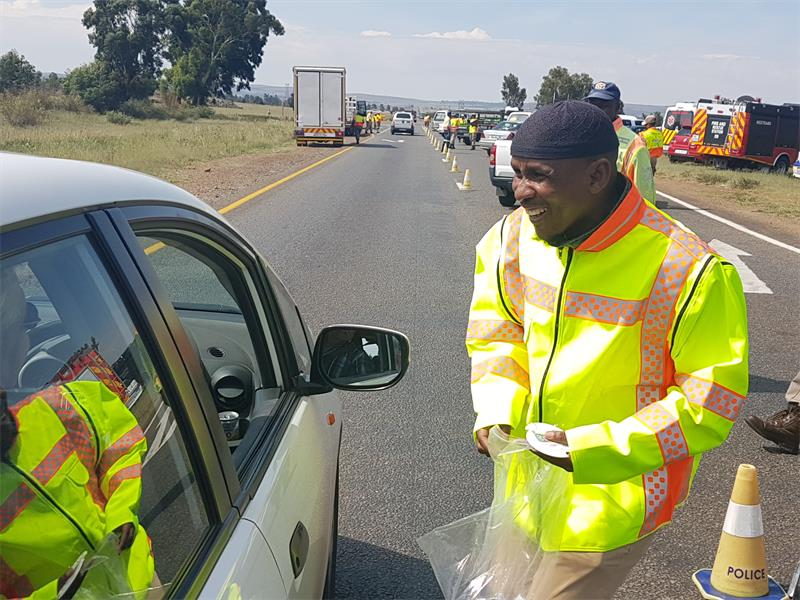 Jeje Legoete, Rand West City Local Municipality MMC for Public Safety engaging with motorists about road safety. Photo: Submitted