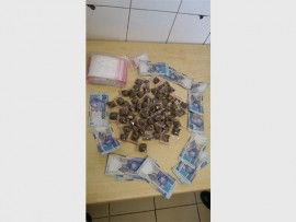 Dagga and money thatwas seized during the arrest of a 49-year-old woman, recently, in Wadeville.