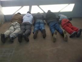 These five men were arrested in Rietfontein Road, Primrose, on Sunday, for the possession of stolen property and business robbery. The arrests were made during a Primrose community, CPF, SAPS and EMPD march against crime in the area.