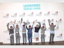 Joyful: The children were happy to receive their new school shoes. Among the excited pupils were, from left; Ayanda Mtshali (9), Asiphile Siphambo (9), Bongekile Balithokazi (9), Puseletso Madihlaba (9), Lindokuhle Joyi (8), Regine Nkhoma (8) and Ashley Molefe (10).