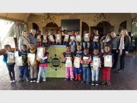 """The excited children from Sinbad Nursery School and Crèche recently collected goods for the """"Blessing in a Bag"""" project. Back, (from left) are: Sybil Bezuidenhout, Karien Keeve (Word and Life Church and one of the Blessing in a Bag organisers), Vanessa Zireva, Tshepo Kgaka, Njabulo Khumalo, Trishana Kate, Katlego Masotla, Tshepang Kgaka, Koketso Mogale, Solethu Buthelezi, Mpho Mollo, Paballo Dolo, Susan Harris (Sinbad teacher) and Chalene Steenkamp (Sinbad marketing coordinator). Front: Ndalo Nd"""
