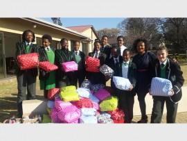 Dawnview High School students visited the children at Epworth Children's Village on August 13. Among those present and ready to gift the youngsters were (from left): Rebecca Kadiebwe, Nelly Phukubye, Tleledi Mokwena, Lerato Mokhoutu, Nkosingiphile Yende, Siphesihle Nzima, Nonhlanhla Mnisi, Ke-Ami Naidoo, Railina Mbatsane, Gladys Bibi-Ndiangang and Adrienne Serra.