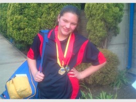 Ten-year-old Nikita Coetzer, from Lambton, proudly shows off the medals she won at the Small Districts Inter Provincial Gala, at the Boksburg North Swimming Pool, recently.