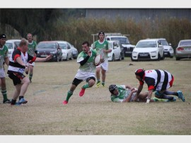An Elsburg Rugby Club player (green) charges for the try line during the team's Kestrel League match against the Heidelberg Rugby Club on Saturday.