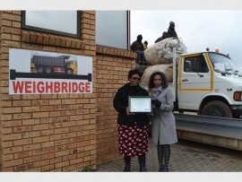 MMC Ndosi Shongwe (left) together with Ekurhuleni's head of department for Solid Waste Service, Qaphile Gcwensa, posing with the recently attained award of the best managed landfill site in Gauteng at the Rooikraal landfill site, in Boksburg.