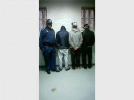 The Primrose police's Capt Jack Mokoena watches over three men arrested for drug possession, recently.