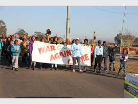Residents and staff of Germiston South-based company Johnson Matthey SA march along the streets of Germiston, last Saturday, to raise awareness about crime in the area.