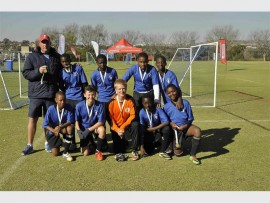 Some of the members of the u-13 football team from St Catherine's are, back, (from left): Chris Palmer (coach), Takudzwa Mandigo, Rivonongo Makhuba, Thando Ndlovu and Coby Quginoo. Front: Tshimolgo Bodigelo, Alessio Bisotto, Christoph Benecke, Lesedi Lebotsa and Sibusiso Mokoena.