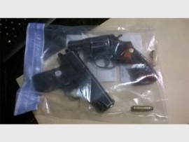 These firearms, one of which is a toy, were confiscated during the arrest of two men in the Delport informal settlement.