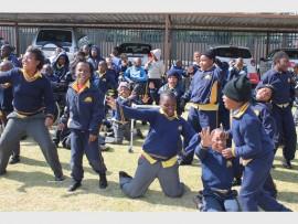 The children from Ithembelihle Lsen School dance on Mandela Day.