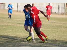 A Germiston City Football Club player (red) and Unaio Desportiva FC player fight for the ball during the sides' Eastern Local Football Association's (ELFA) Super League match, on Saturday, at the Germiston City Sports Club.