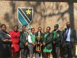 Showing off the trophy they won at the provincial-leg of the competition are, from left, Maureen Khumalo (Dawnview High's deputy principal), Mpho Maphisa (English teacher), Lungelo Sehlogo, Noluthando Dube, Thato Mtubane, Malekotsi Ramabelesa, Lungile Zulu and the school's principal Moeketsie Kolokoto.