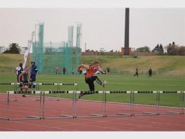 Roelof van der Merwe (16) leads the way during a hurdles event.