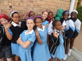 Here David Pyott (back, left), Zahara Makhaya, Oratilwe Mashigo, Stephanie Pretorius, Kgotso Moshugi, Zenande Nxumle, Christin Quaninoo, Teija Ashby (front, left), Neha Ramsingh and Amahle Nkosi show off their bandanas.