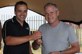 Meat World CEO Angelino Pereira hands over the keys of the new Mitsubishi to Craig Westoby.