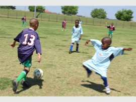 Thando Magagula, of Ayoba, pushes to get the ball past Gift Masombuka, of Lusitano FC.