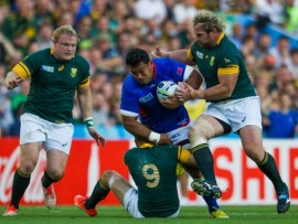 Samoa's Ofisa Treviranus is tackled by Fourie du Preez and Jannie du Plessis during the 2015 Rugby World cup match-up between South Africa and Samoa at Villa Park in Birmingham. - Image by © Andrew Patron/ZUMA Press/Corbis