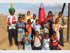 Bigger Walker Boxing Club members with their coach, Charles Mtshali (left, with boxing gloves).