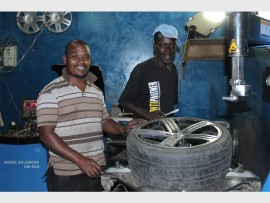 Bongani Mlotshwa (left), with one of his employees, George Gwebu, who works as a tyre fitter.