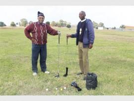 Oldies Gabriel Putsoe (left) and Veli Zwane enjoy a Saturday afternoon on the green.