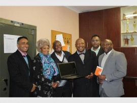 Deputy chief education specialist Poovan Chetty (left), CEO of AfriSun Pumla Mutle, LCD manager Takalani Nethengwe, prinicpal Godfrey Mononyana, IT manager Vikesh Naidoo and CSI manager Mdu Madonsela during the awarding of the laptop.