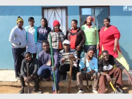 Early Childhood Development practitioners with some of the artists who cleaned the centre.