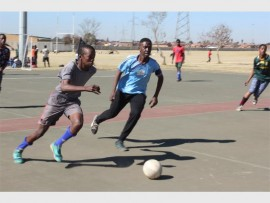 Andile Mnyanda of Azishe (left) and Mzwakhe Mbonani of Kwalala compete for the ball.