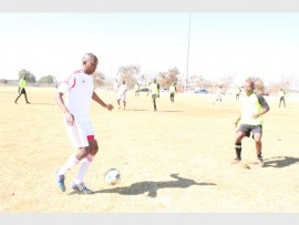 Thabo Mphati (left) keeps the ball away from opponent Thabo Mabena of RDP.