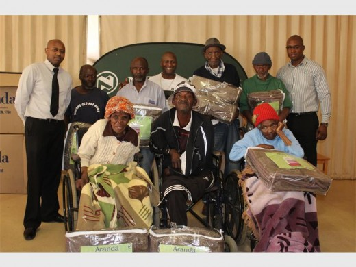 Some of the oldies received blankets from the bank employees. Back (from left): branch manager Lerato Masangane, Kenny Nkosi, Lawrence Ngwenya, centre manager Phoko Mokubung, Stanley Dube, Boy Zikhali and branch manager Thabo Mofolo. Front: Mantsundu Mqhele, Tebogo Chilwane and Mulelekeng Kopman.