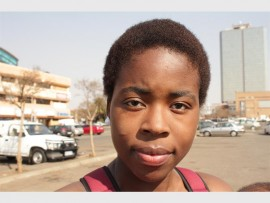 """Precious Mthimkhulu (24): """"I don't think it's necessary for us to go back to practicing old customs because we live in Western times and everything has changed, we have found easier ways to do things."""""""