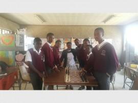 The Laban Motlhabi Secondary School chess team seen with their coach Elizabeth Mokone.